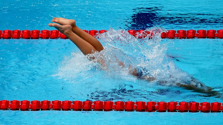 Australian Olympic swimmer hospitalized with COVID-19