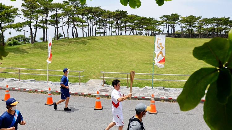 Olympic torch relay detour; diving test event opens in Tokyo
