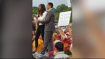 A 'Gameday' fan's clever sign got him a lot of beer money. Now he's donating it all.