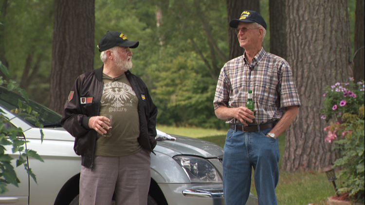 Ted Cynor (left) shares a beer with his Vietnam War buddy Vern Ehnert.