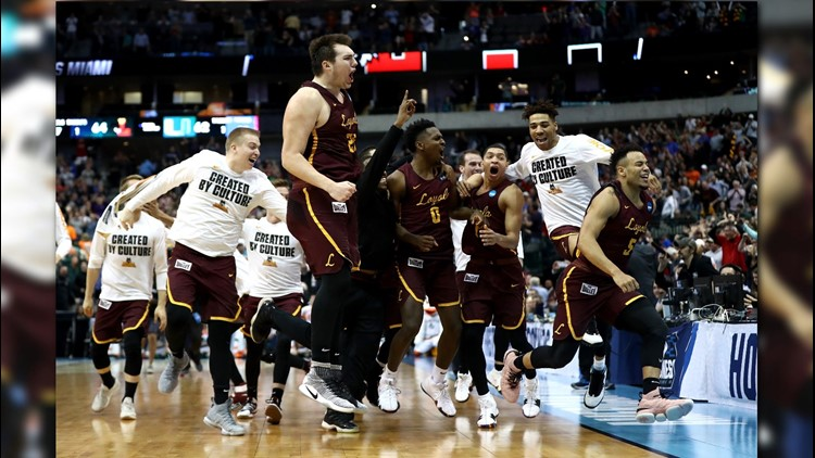 The Loyola Ramblers celebrate after a game-winning three against the Miami Hurricanes in the first round of the 2018 NCAA Men's Basketball Tournament at American Airlines Center on March 15, 2018 in Dallas. Photo by Ronald Martinez/Getty Images