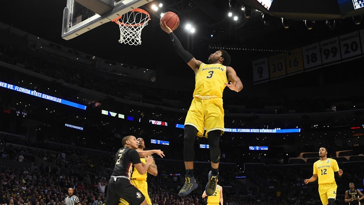 Michigan Wolverines guard Zavier Simpson shoots against the Florida State Seminoles in the championship game of the West regional of the 2018 NCAA Tournament at STAPLES Center. Photo by Richard Mackson-USA TODAY Sports
