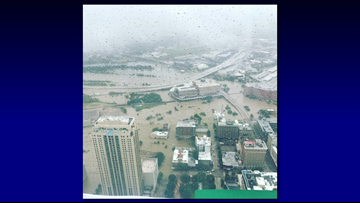 Photos shows widespread flooding in downtown Houston