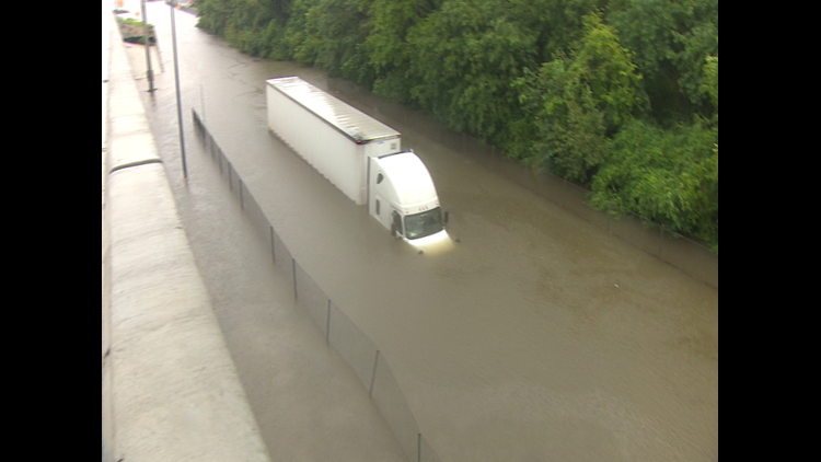 "Robert Roberson says he was following another truck on the North Sam Houston Tollway frontage road when ""the water hit me."""