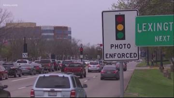 Gov. Abbott signs bill banning red light cameras in Texas