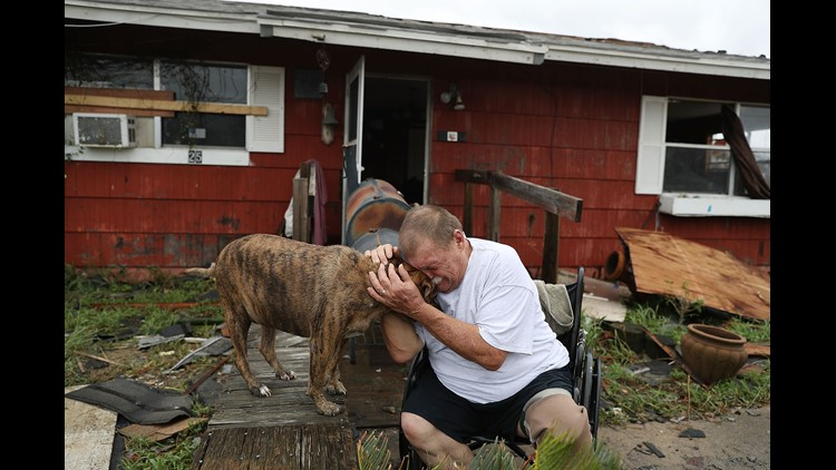 "Steve Culver cries with his dog Otis as he talks about what he said was the, ""most terrifying event in his life,"" when Hurricane Harvey blew in and destroyed most of his home while he and his wife took shelter there in Rockport, Texas."
