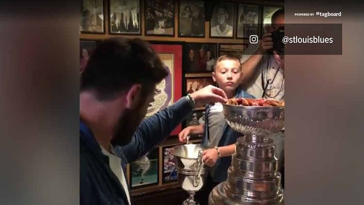 St. Louis Blues Pat Maroon, Laila Anderson eat toasted ravioli out of Stanley Cup