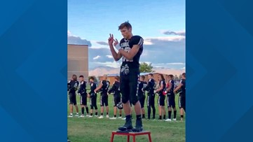 High School football player signs the national anthem at a home game, and the video goes viral