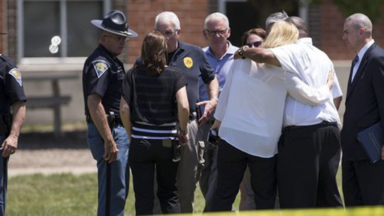 Hugs as top ranking officials meet just before a press conference on the lawn outside Noblesville West Middle School. (Photo: Robert Scheer/IndyStar)