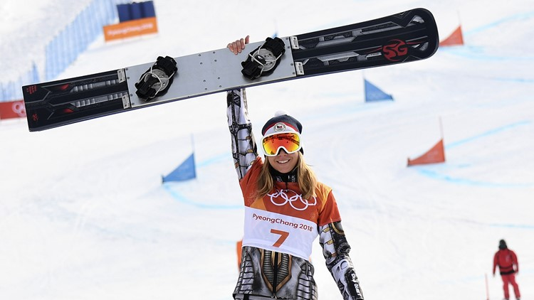 Gold medallist Czech Republic's Ester Ledecka celebrates on the podium during the victory ceremony for the women's snowboard parallel giant slalom event during the Pyeongchang 2018 Winter Olympic Games on February 24, 2018.