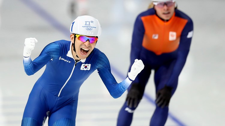 Seung-Hoon Lee of Korea celebrates winning the gold medal as Koen Verweij of Netherlands takes the bronze during the Men's Speed Skating Mass Start Final during the Winter Olympic Games on February 24, 2018.
