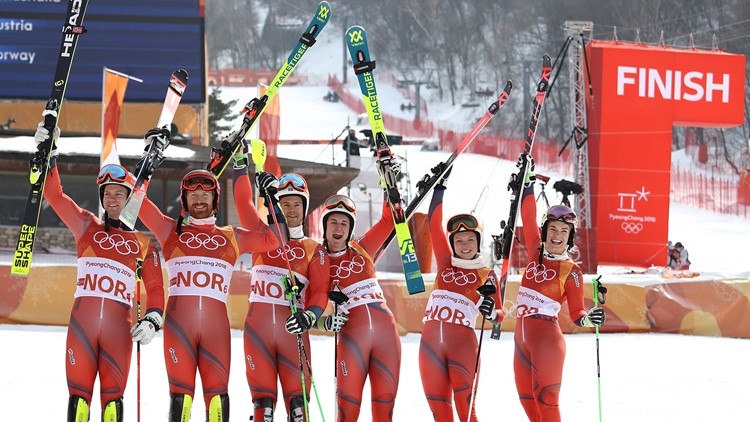 Bronze medallists Norway with Jonathan Nordbotten, Leif Kristian Nestvold-Haugen, Sebastian Foss-Solevaag, Maren Skjoeld, Kristin Lysdahl and Nina Haver-Loeseth celebrate during the victory ceremony for the Alpine Team final on February 24, 2018.