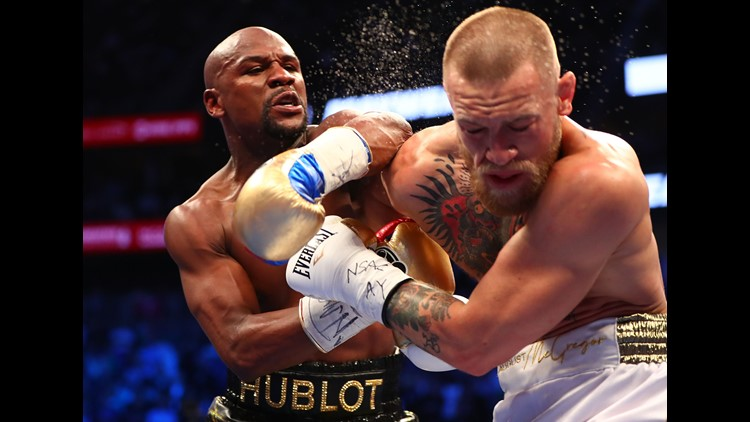 Aug 26, 2017; Las Vegas, NV, USA; Floyd Mayweather Jr. lands a hit against Conor McGregor during their boxing match at the at T-Mobile Arena.