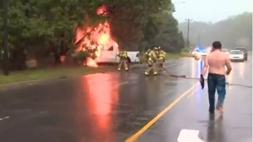 Good Samaritans rescue man after truck hits tree, catches fire