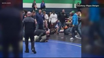 Dad charged with assaulting student who was wrestling son during tournament match