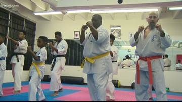 Karate instructor saves woman from attempted kidnapper, helps police arrest suspect