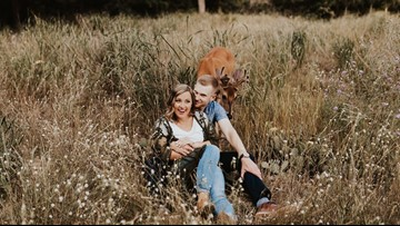 Picture perfect: Deer photobombs couple's engagement shoot