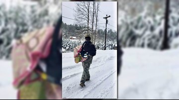 Winston-Salem National Guard Soldier Carries Baby Through Snow