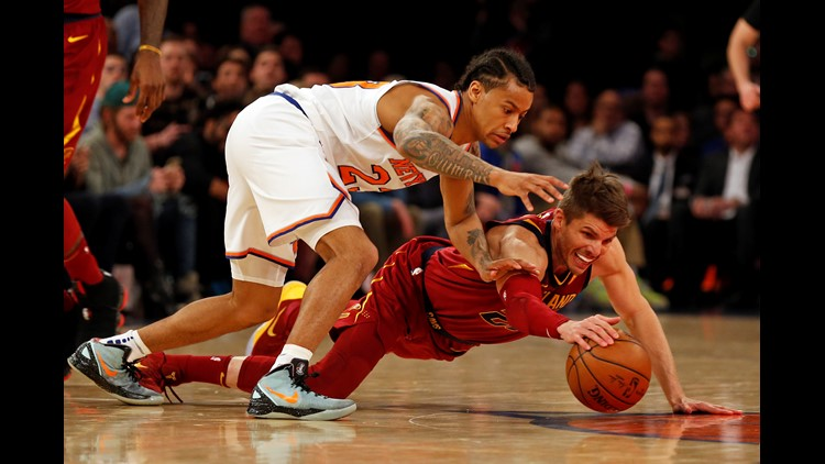 Cleveland Cavaliers guard Kyle Korver (26) battles for a lose ball with New York Knicks guard Trey Burke (23) during the first half at Madison Square Garden.