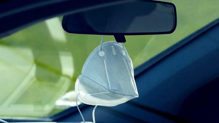 Don't hang face masks on your rear-view mirror, AAA advises