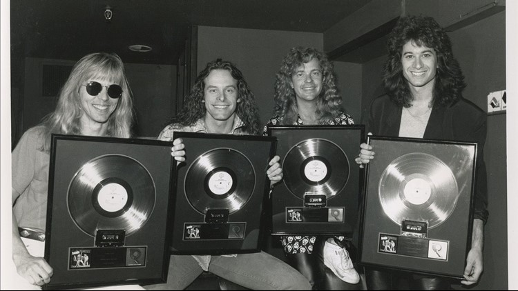 Damn Yankees members receiving gold records in acknowledgement of their debut album selling 500,00 copies.
