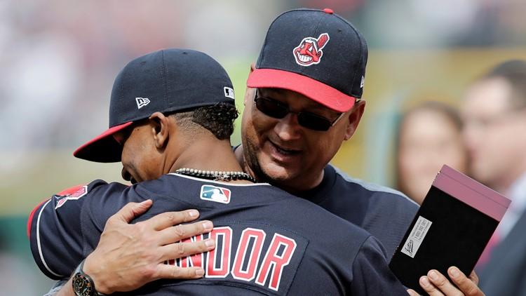 Cleveland Indians SS Francisco Lindor hugs manager Terry Francona