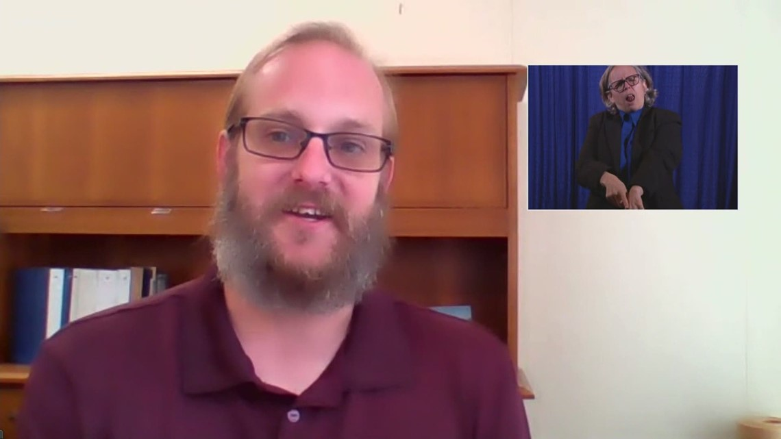Second Vax-a-Million winner Jonathan Carlyle of Toledo reacts to winning $1 million