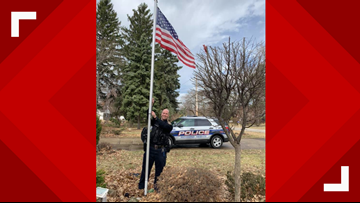 Richmond Heights Police replace elderly woman's tattered old American flag with new one
