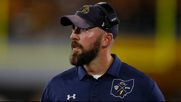 Kent State runs past Eastern Michigan 34-26 to clinch bowl eligibility