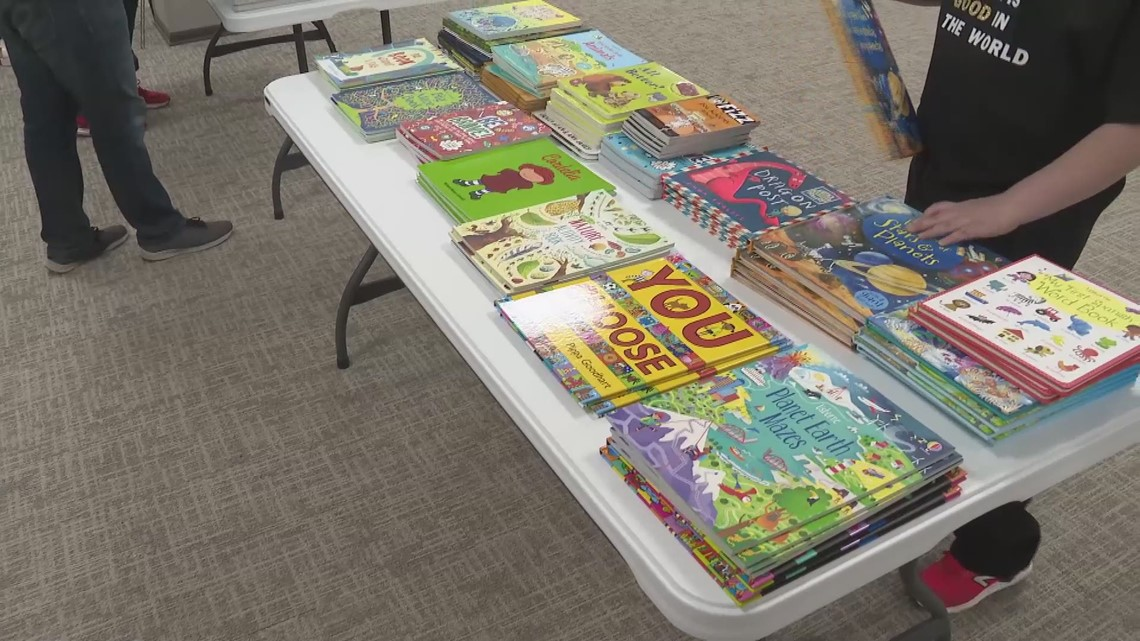 Young kid helps out the community by purchasing books for police officers to give back to children