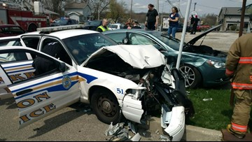 Car crashes into Akron police cruiser assisting with funeral procession