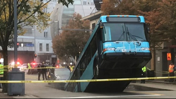Sinkhole opens, swallows part of city bus during rush hour in Pittsburgh