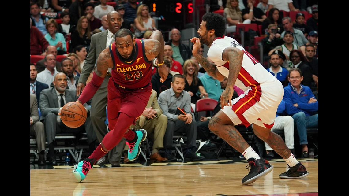 3cd11555b08 Cleveland Cavaliers forward LeBron James (23) drives the ball around Miami  Heat forward James Johnson (16) during the first half at American Airlines  Arena.
