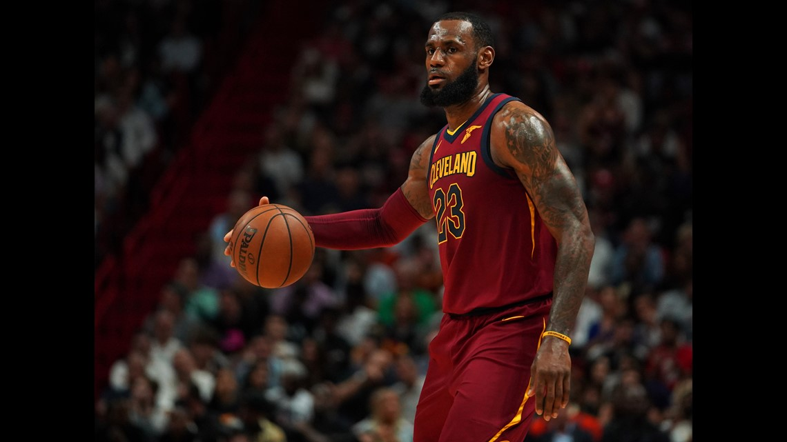 45ff6456345 Cleveland Cavaliers forward LeBron James (23) controls the ball against the  Miami Heat during the first half at American Airlines Arena.