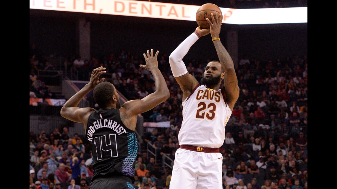 e06e2fe80fc5 Cleveland Cavaliers forward LeBron James (23) shoots as he is defended by  Charlotte Hornets forward Michael Kidd-Gilchrist (14) during the first half  at the ...