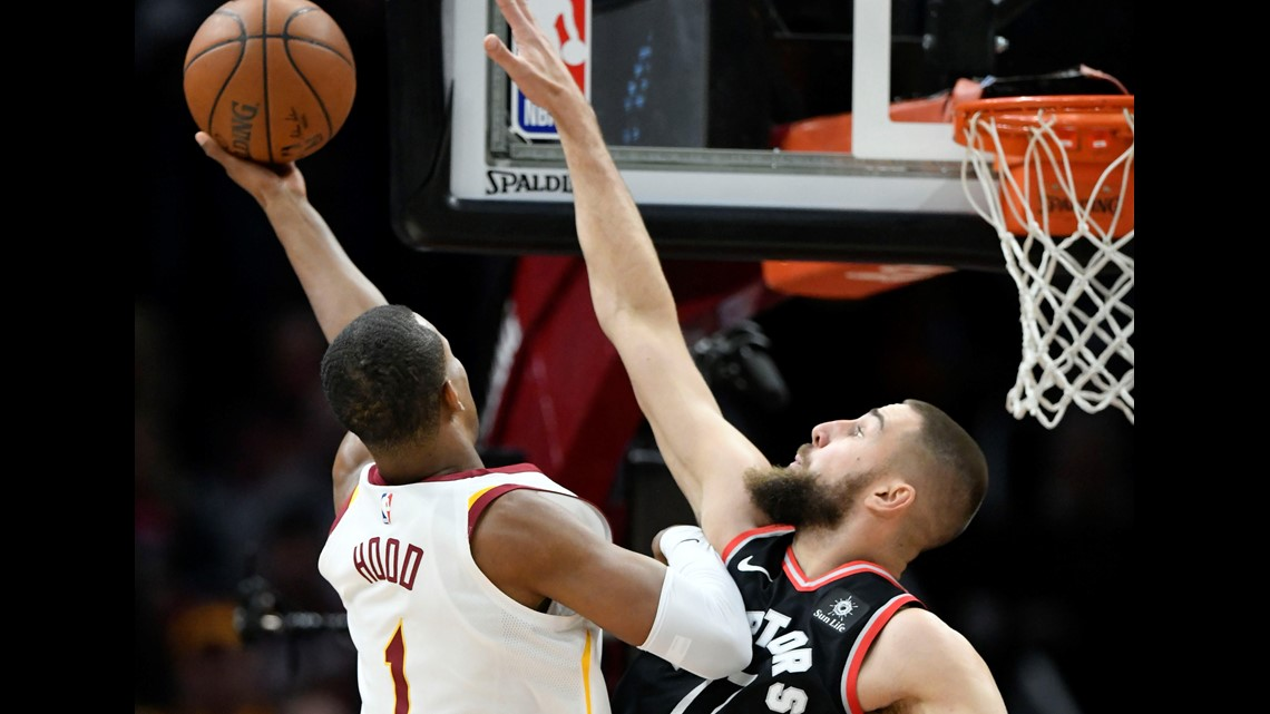 Toronto Raptors center Jonas Valanciunas (17) defends a shot by Cleveland  Cavaliers guard Rodney Hood (1) in the first quarter at Quicken Loans Arena. 7fc4adac8