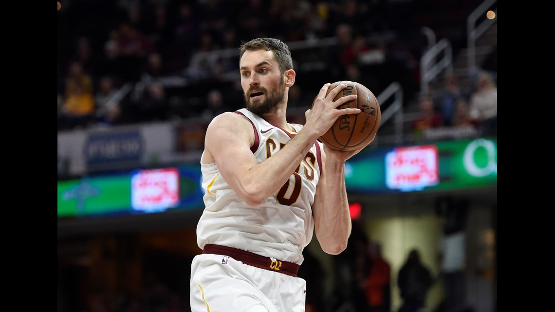 Cleveland Cavaliers center Kevin Love (0) pulls down a rebound in the first  quarter against the Toronto Raptors at Quicken Loans Arena. a8f0a4997