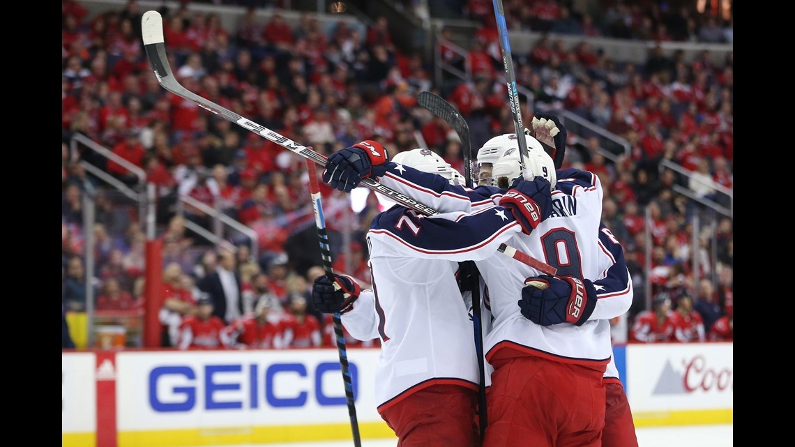 ee8d1a625c9 Columbus Blue Jackets defenseman Zach Werenski (8) celebrates with  teammates after scoring a goal against the Washington Capitals in the  second period in ...