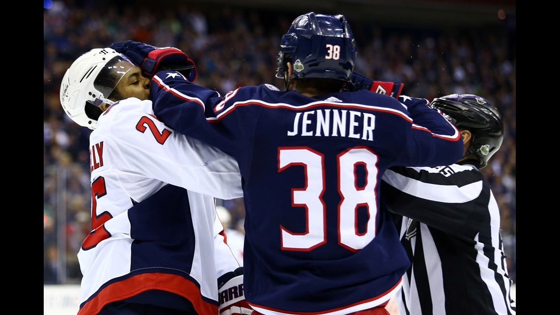 816caca9fc9 Washington Capitals right wing Devante Smith-Pelly (25) is punched by Columbus  Blue Jackets center Boone Jenner (38) during a stop in play in the first ...