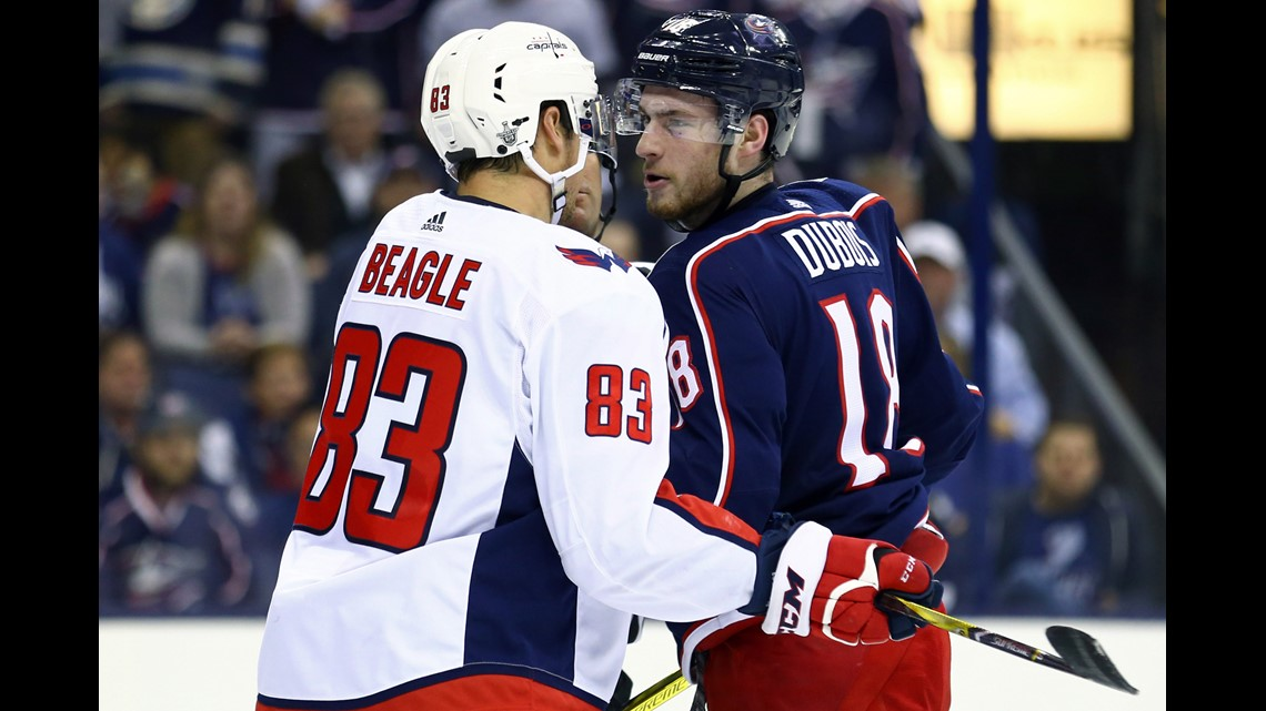 1d6d9840b03 Washington Capitals center Jay Beagle (83) exchanges words with Columbus  Blue Jackets center Pierre-Luc Dubois (18) during a stop in play in the  first ...