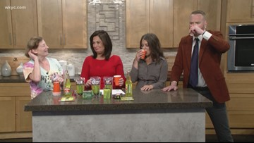 Mike Polk Jr. and Danielle Serino try pickle soda in preparation for the Cleveland Pickle Fest
