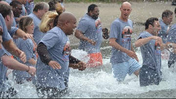 WATCH | Cleveland Browns coach Hue Jackson pays off promise and jumps into Lake Erie