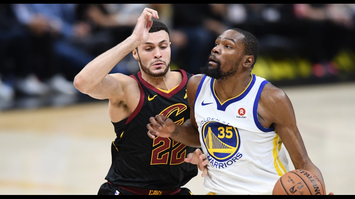 e63e98d49d9 Golden State Warriors Kevin Durant drives to the hoop against Cleveland  Cavaliers center Larry Nance Jr. in Game 3 of the 2018 NBA Finals at  Quicken Loans ...