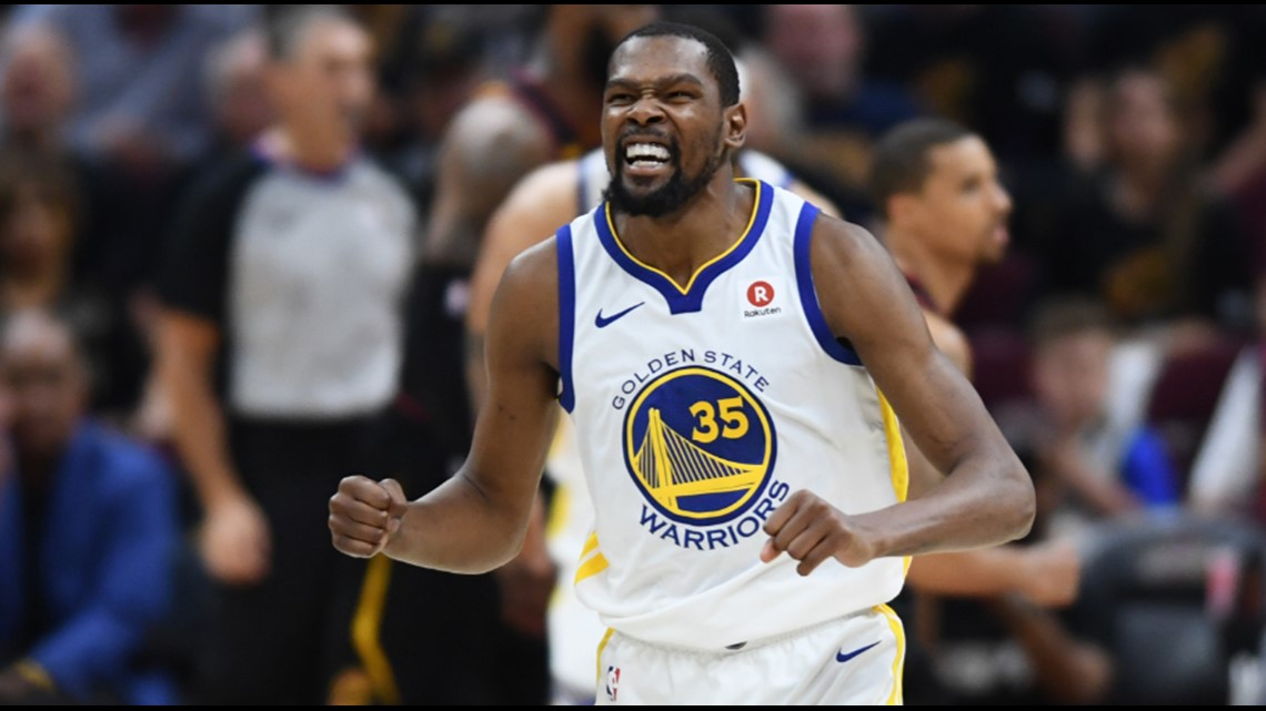 e1142f22e1d Golden State Warriors forward Kevin Durant celebrates after throwing down a  dunk against the Cleveland Cavaliers in the first half of Game 4 of the  2018 NBA ...
