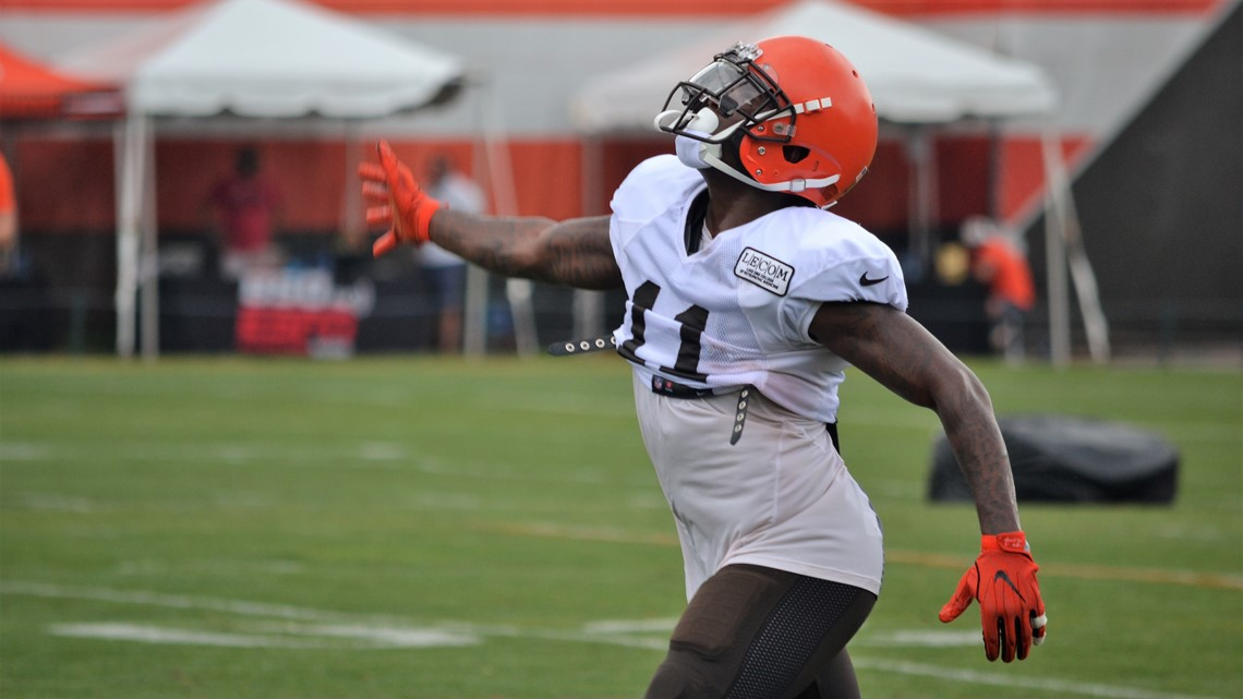 1003c2167 Cleveland Browns wide receiver Antonio Callaway signals for a fair catch on  a punt return during a recent training camp practice at team headquarters in  ...