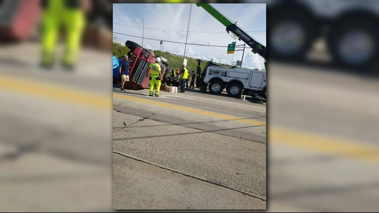 Overturned tractor trailer closes roads in Lake County