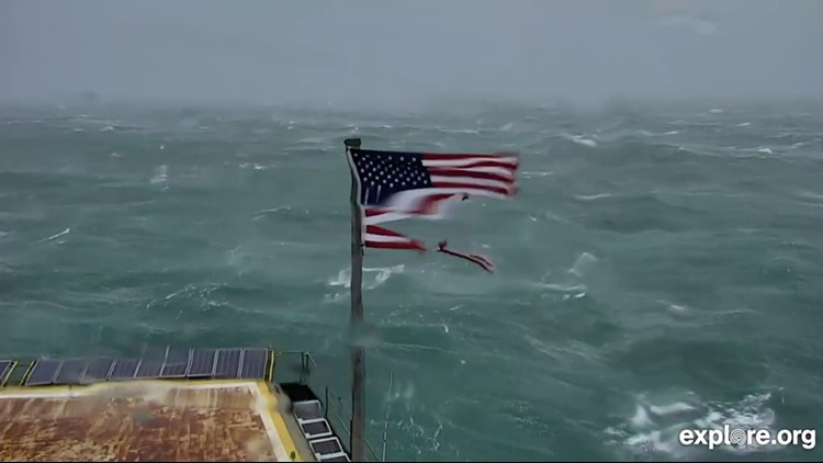 The most striking image is perhaps that of an American flag, tattered and worn in the strong winds.