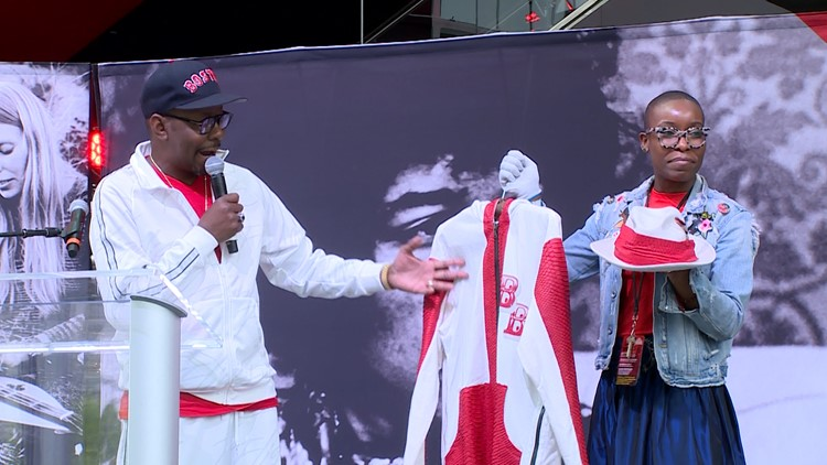 Bobby Brown donates a custom suit to Nwaka Onsuna, Director of Curatorial Affairs for the Rock and Roll Hall of Fame