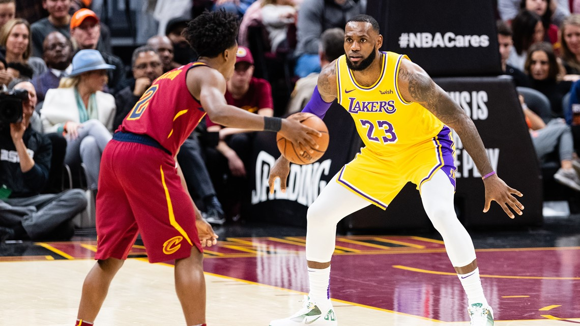 4e9bc151ba98 Los Angeles Lakers forward LeBron James guards Cleveland Cavaliers rookie  point guard Collin Sexton during the first half at Quicken Loans Arena in  ...