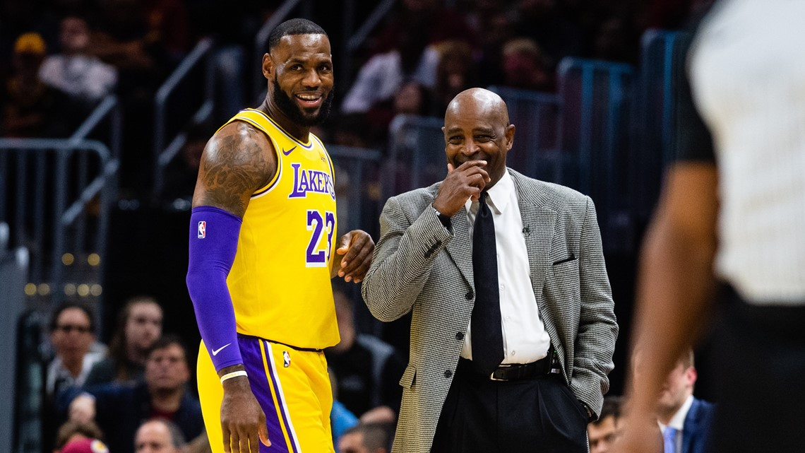 a2b793e4d6f7 Los Angeles Lakers forward LeBron James talks with Cleveland Cavaliers  coach Larry Drew during the first half at Quicken Loans Arena in Cleveland